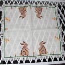 Vezen prtiček z zajčki, 35 x 35 cm. IC = 2 eur