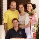 My step-father, me, my sister and our mom